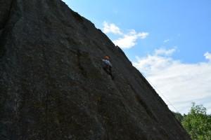 Thomas climbing Practice Rock.